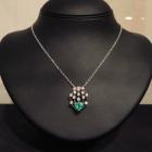 Ciondolo gabbietta-smeraldo a cuore e brillanti